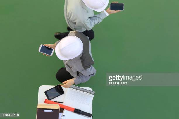 business man and woman holding smart phone