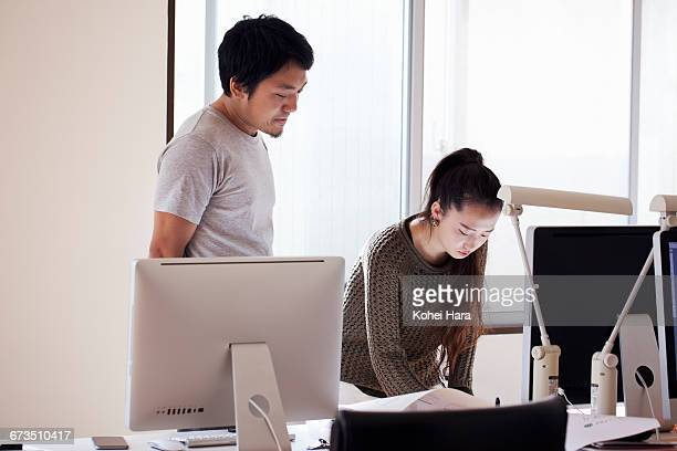 business man and woman working at office