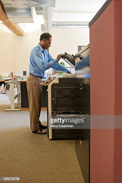 Business man at copy machine