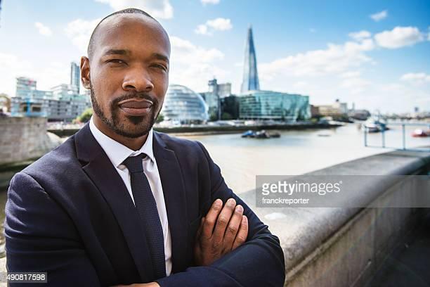 Business man at tower bridge in London