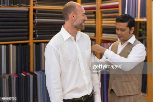 Business Man Being Measured For a Custom Tailored Suit