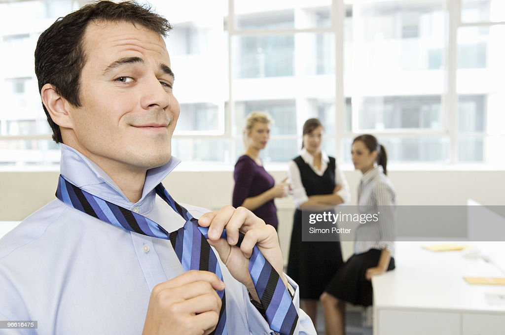 Business man being watched by the girls : Stock Photo