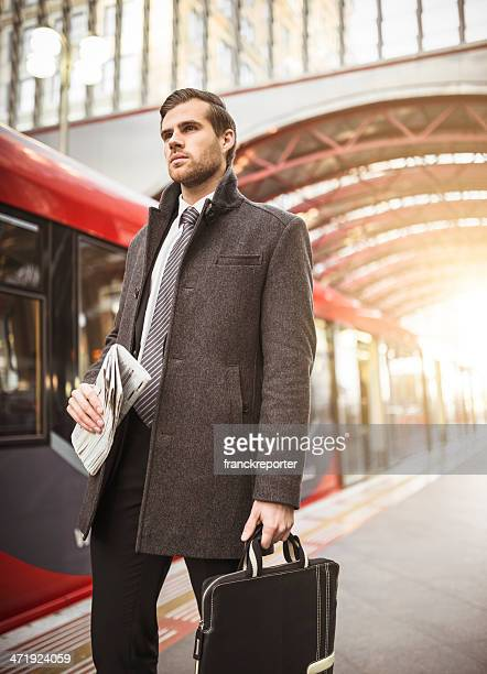 Business man catching the train on railway station