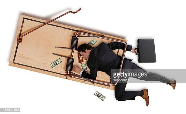 business man caught in a trap - symbolism stock pictures, royalty-free photos & images
