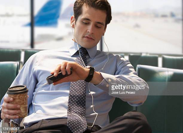 Business man checking the time at airport