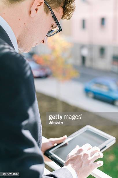Business man checks digital tablet