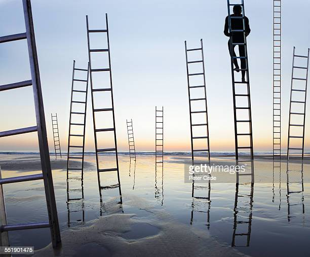business man climbing a ladder,beach ladders - chance stock pictures, royalty-free photos & images