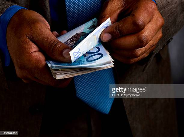 Business man counting euro bills