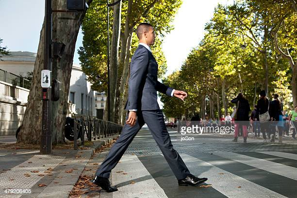 business man crossing the street, paris - crossing stock pictures, royalty-free photos & images
