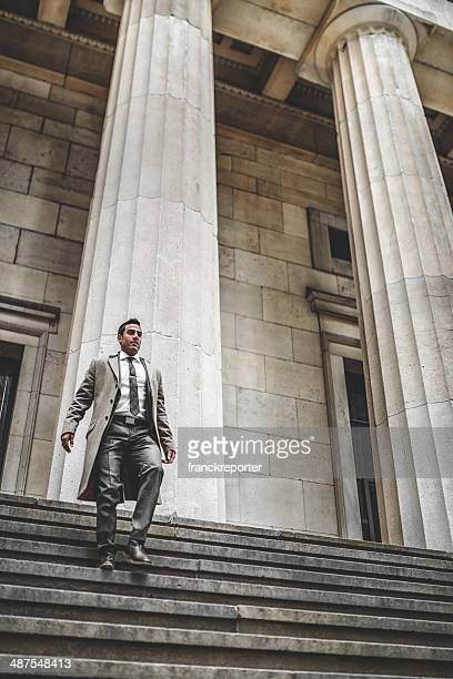 business man descending the steps on wall street