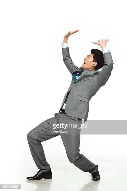 A business man do weight-bearing posture