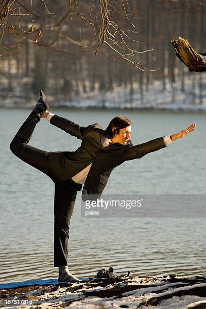 Business Man does Yoga in the woods