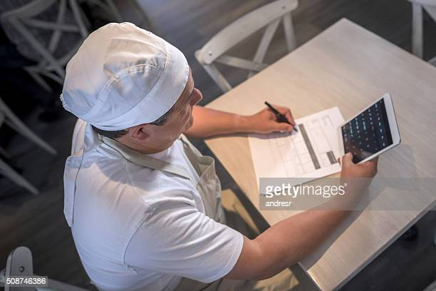 Business man doing the books at a cafe