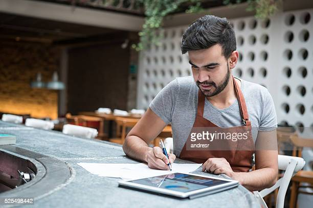 Business man doing the books at a restaurant