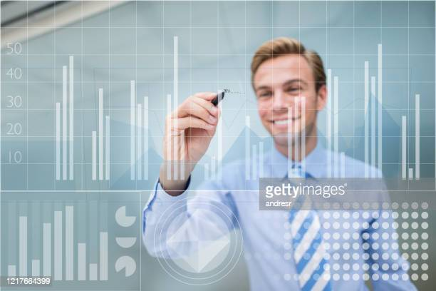 business man drawing a growth graph at the office - market stock pictures, royalty-free photos & images