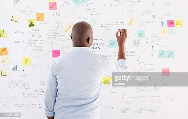 business man drawing a plan at the office - business plan stock pictures, royalty-free photos & images