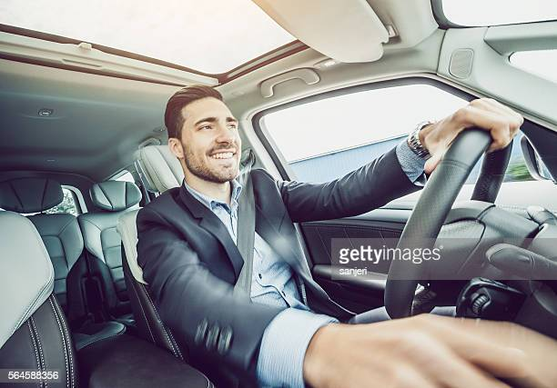 Business Man Driving the Car