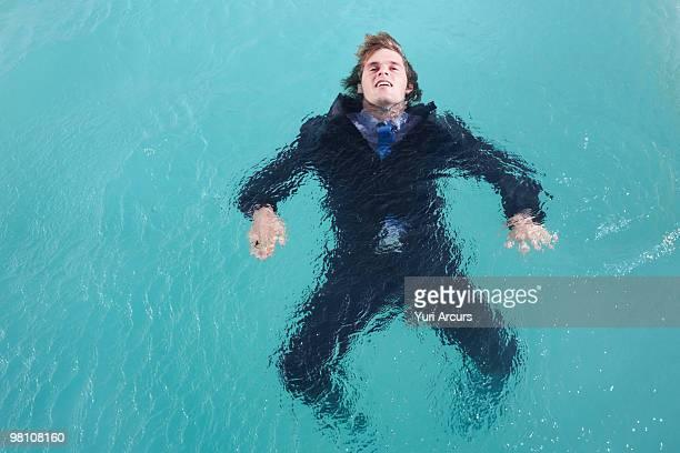 Business man drowning in water