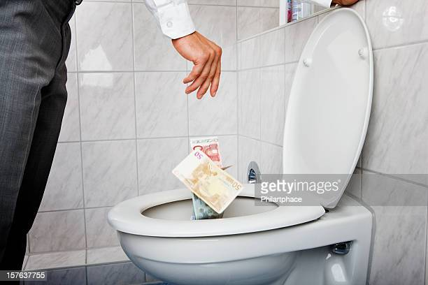 business man dumping money