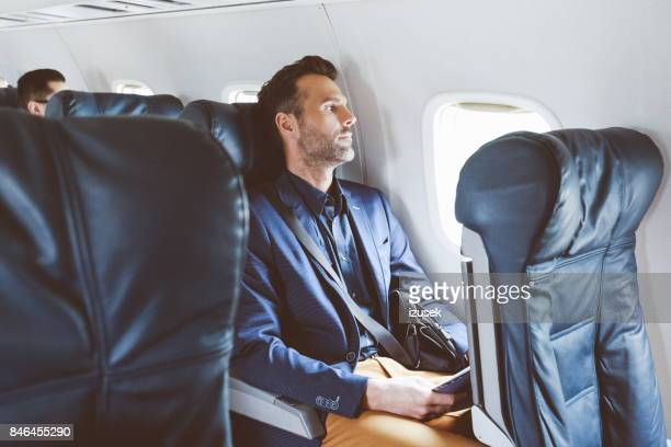 Business man flying by plane