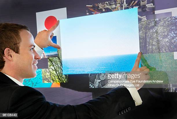 """business man framing a digital photo with his hand - """"compassionate eye"""" stock pictures, royalty-free photos & images"""