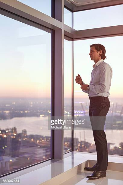 Business man getting ready in apartment