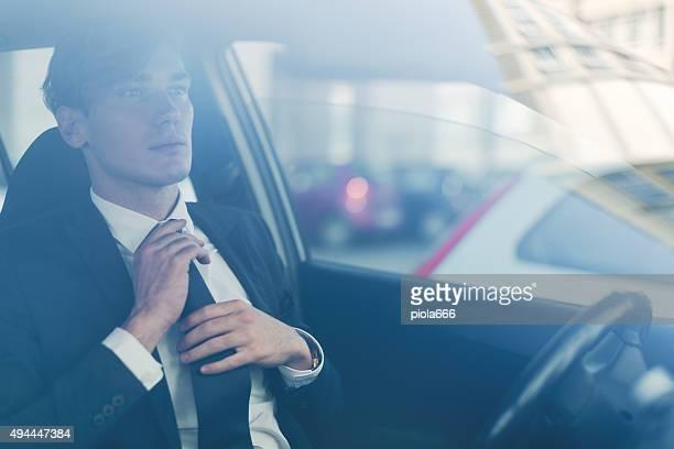 Business man getting ready inside a car