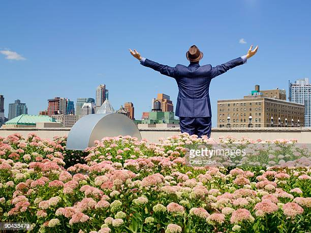 Business man greening his city roof