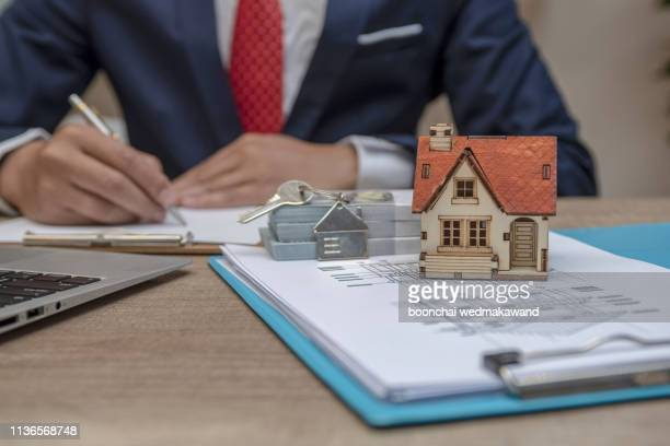 business man hand key and house model - grounds stock pictures, royalty-free photos & images
