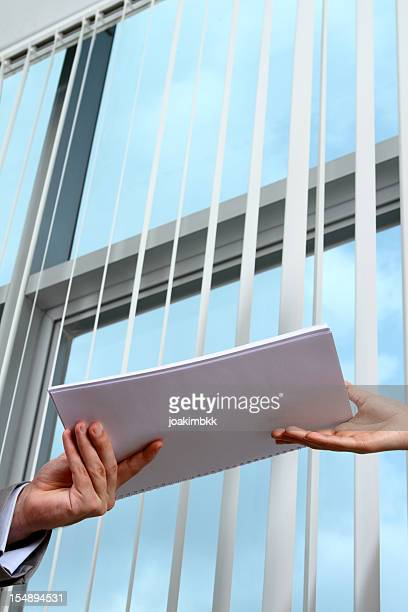 Business man handing documents over