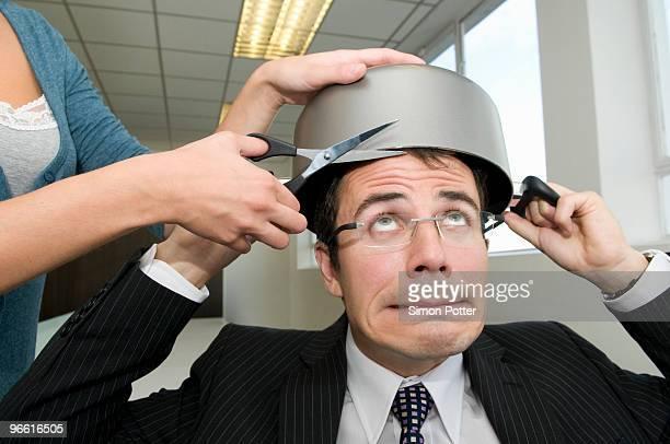 Business man having a hair cut