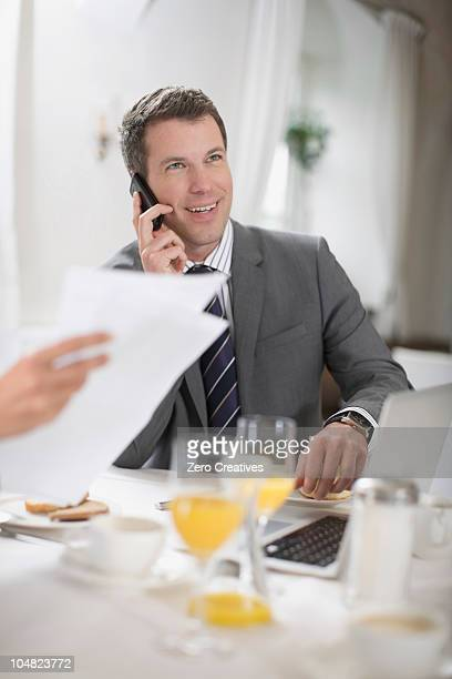 Business man having breakfast