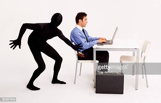 business man having his identity stolen