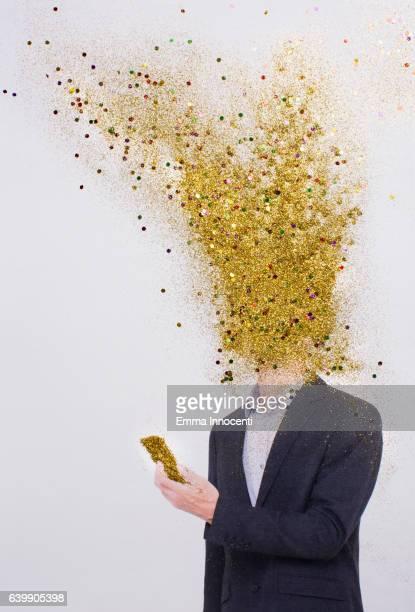 business man head exploding into gold dust - explosion stock-fotos und bilder