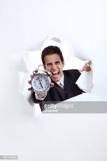Business Man Holding a Alarm Clock