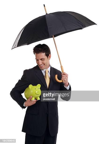 Business-Mann hält ein Sparschwein