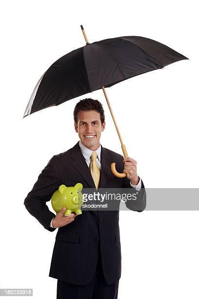 Business Man holding a Piggy Bank