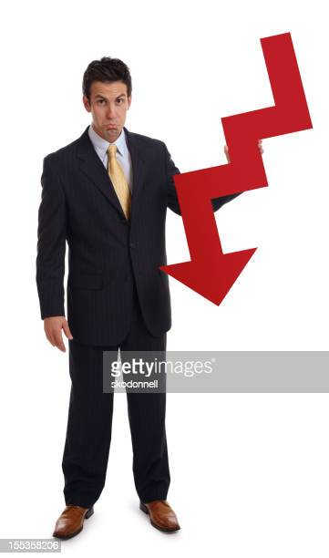 Business Man Holding a Red Down Arrow