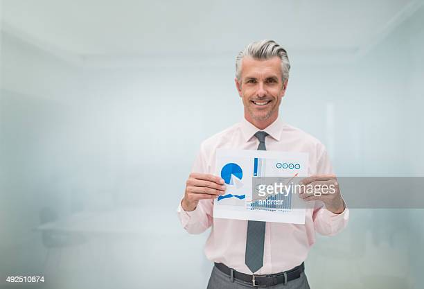 Business man holding document with statistics