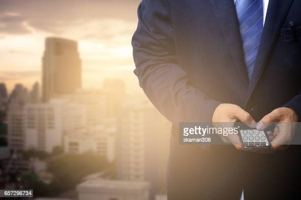 Business man holding smart-phone and talk our business