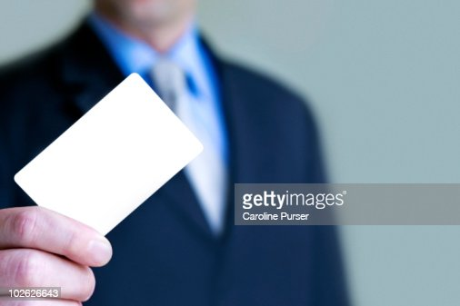 Business man holding up blank business card stock photo getty images reheart Choice Image