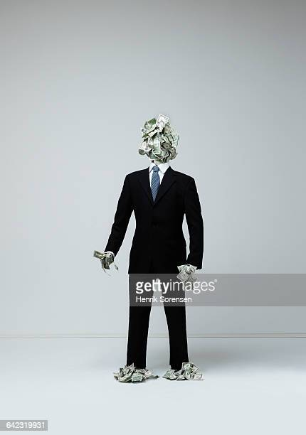 Business man/ human figure created by money