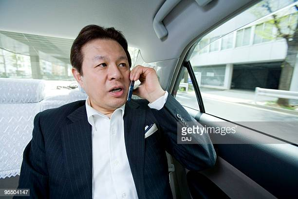 A Business Man in a Taxi
