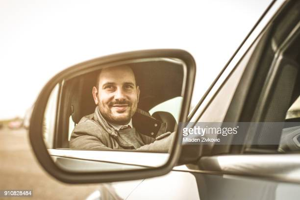 business man in car. - vehicle mirror stock photos and pictures