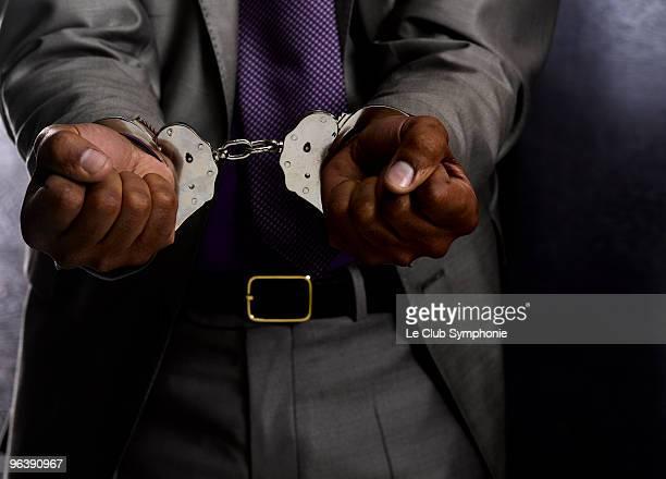 business man in handcuffs - 逮捕 ストックフォトと画像