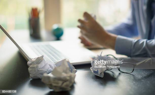 Business man in office with burnout syndrome at desk, Business man hard working in the papers