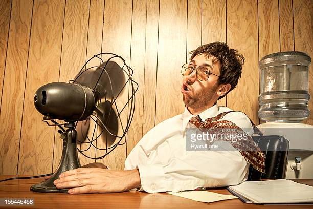 business man in office with fan - heat stock pictures, royalty-free photos & images