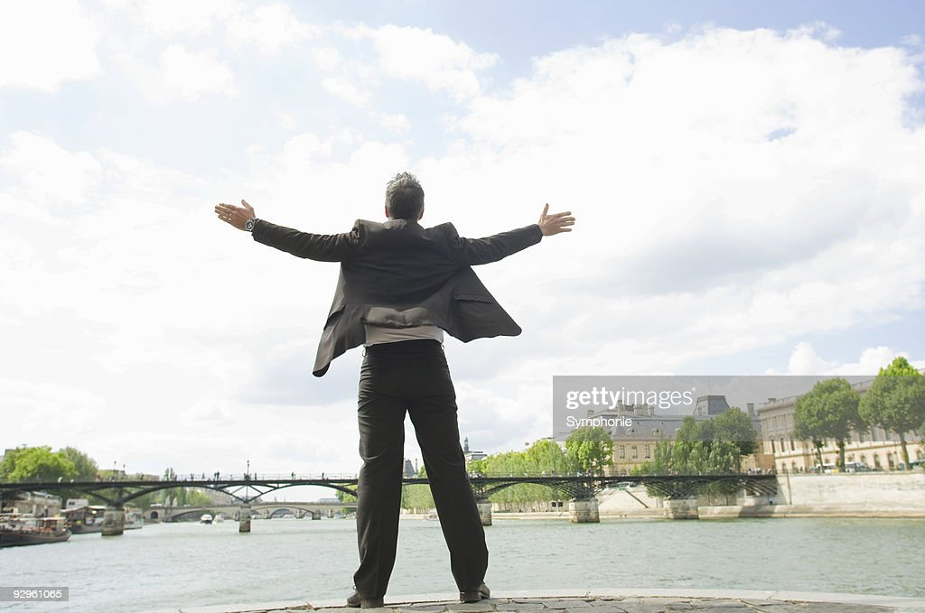 business man in paris with outstretched arms in stock photo getty