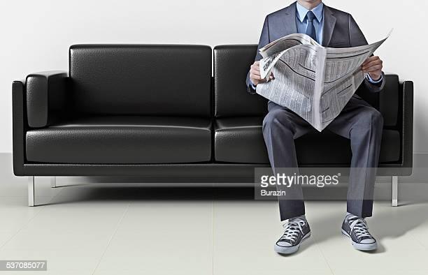 Business man in suit wearing sneakers
