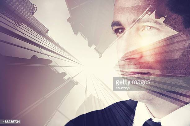 Business man in suit with cityscape montage.